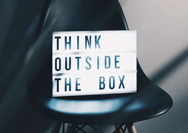 sign in chair that says think outside the box